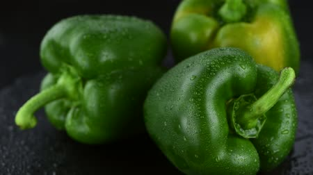 pimentas : Fresh green rotating peppers as 4K not seamless loopable footage Stock Footage