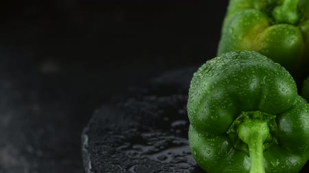 pimentas : Rotating green peppers (4K; not seamless loopable) Stock Footage