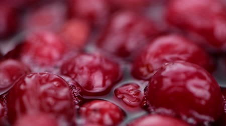 клюква : Portion of preserved cranberries (rotating, 4K, seamless loopable)