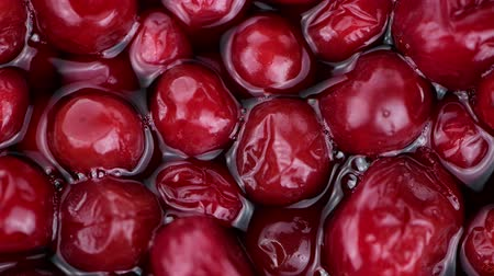 клюква : Preserved Cranberries (rotating, 4K, seamless loopable) Стоковые видеозаписи