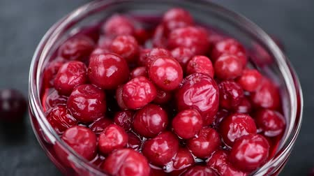 клюква : Portion of preserved cranberries in 4K (rotating, seamless loopable)