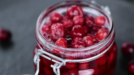 megőriz : Portion of preserved cranberries (rotating, 4K, not seamless loopable)
