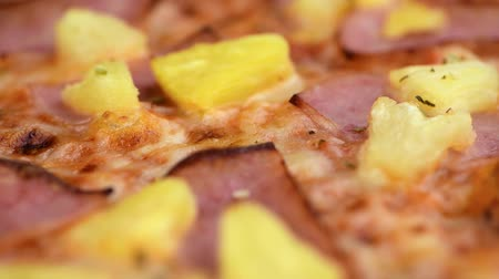cheese slices : Hawaiian Pizza rotating on a plate (seamless loopable, 4K)