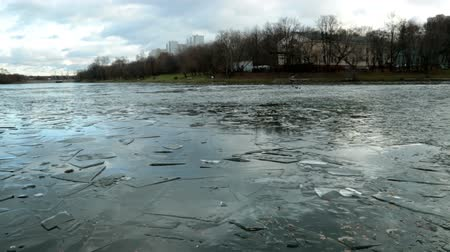 disko : Pond with ice formed in December, and the city HD Stock Footage