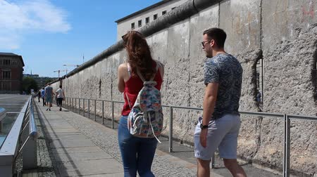 ss : tourist couple at Berlin Wall