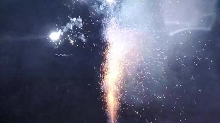 slomo : firework slow motion on black background - fountain fireworks explosion in slow motion