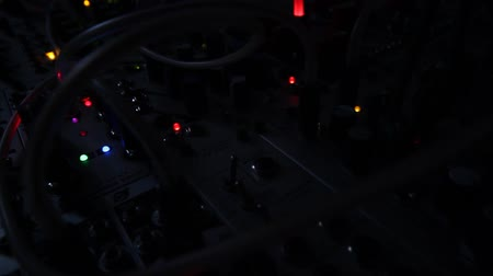electro : colorful blinking lights of electronic music synthesizer equipment -