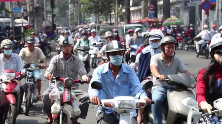 vietnamec : Saigon, Vietnam - june 7, 2016: Crowded city traffic with many scooter driver in saigon, Vietnam. Saigon is known as motorbike city.