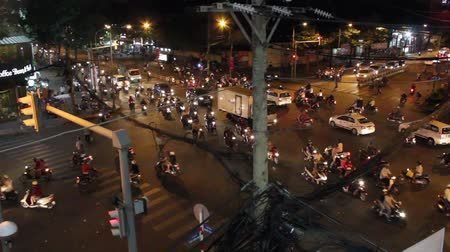cyclists : Crowded street traffic with many motor bikes and scooters in Ho Chi Minh City  Saigon, Vietnam. Stock Footage