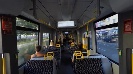 inside bus : Berlin, Germany - august 25, 2016: People driving metro train  tram in Berlin, Germany