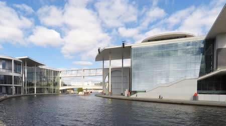 chancellery : Berlin city time lapse - Spreebogen  government district - tourist boats on river spree