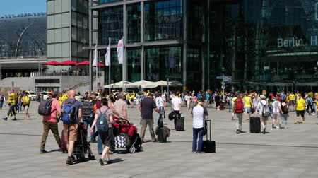 finale : People arriving and departing at Berlin main station (main train station) on a summer day.
