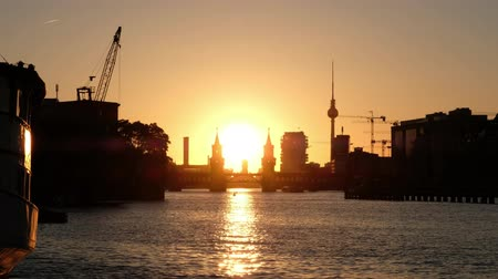 berlin skyline : Berlin skyline: Oberbaum Bridge, river Spree, tower and sunset sky background