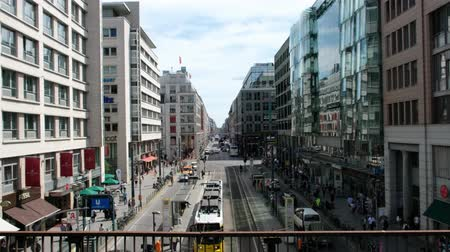 friedrichstrasse : Busy street life, many people and traffic on crowded Friedrichstrasse, a famous shopping street in Berlin, Germany