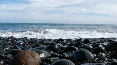 ocean waves on pebble stone beach - stones on sea coast Stock Footage