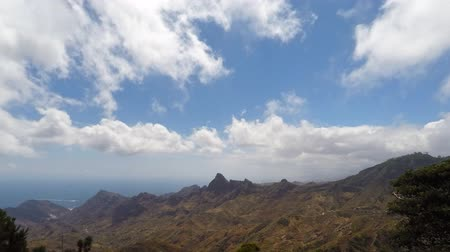 Blue skies and clouds in a mountain landscape with beautiful green valley Vídeos