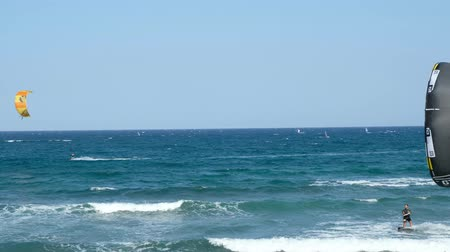 canário : Many kiteboarders and windsurfers surf on famous surf beach at El Medano at Tenrife, Canary Island, Spain