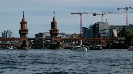 pitka : Tourist boats on river Spree at Oberbaum Bridge (Oberbaumbruecke) in Berlin, Germany