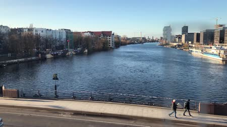 oberbaum : Berlin, Germany - january 2019: Slow motion cityscape of crossing Oberbaum Bridge (Oberbaumbruecke) with elevated train on a sunny day filming river and skyline in Berlin Stock Footage