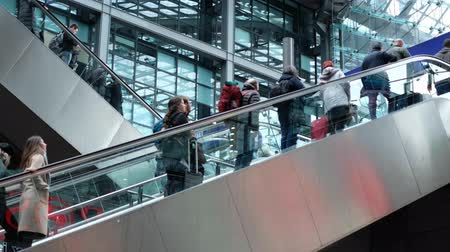 old times : People on escalator inside train station in Berlin, Germany