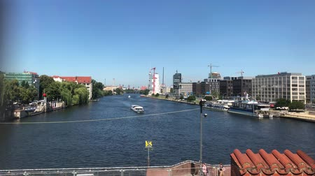 pitka : Berlin city skyline and river View of Oberbaum Bridge on a sunny summer day