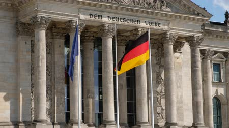 coalition : The flag of Germany and the European Union at the Reichstag building in Berlin, Germany
