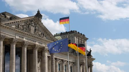 bundestag : German flags and flags of the European Union at the Reichstag building in Berlin, Germany Stock Footage
