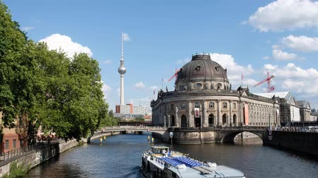 pitka : Boat on river Spree in Berlin near Museum Island and TV Tower on sunny summer day