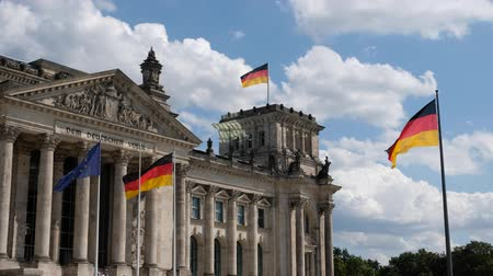 coalition : German flags and flags of the European Union at the Reichstag building in Berlin, Germany Stock Footage