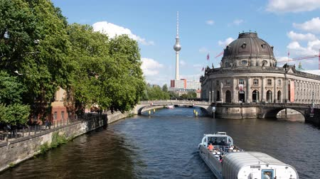 pitka : Tourist boat on river Spree near Museum Island and TV tower on summer day in Berlin, Mitte