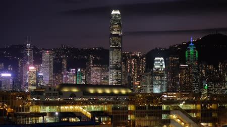 City lights and skyline of HongKong Island with illuminated skyscrapers at ni