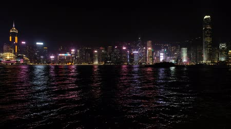 City skyline of HongKong Island with illuminated skyscrapers at night, view f