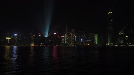 Skyline of Hong Kong Island at night with Symphony of Lights light show Stock Footage