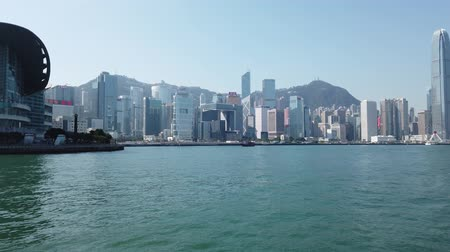 merkezi : Hong Kong Island skyline by boat, coast of HogKong skyscapers in business dis Stok Video