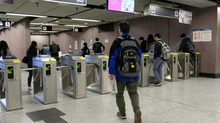 polip : People entering MTR station  subway train station in Hong Kong Stock mozgókép