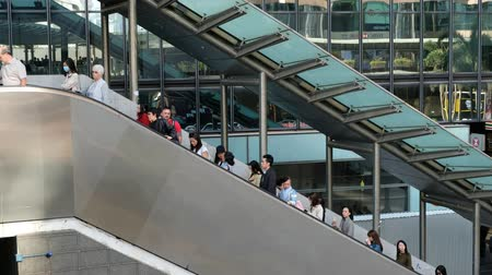 hurry up : People on escalator, going to work in business district in Hong Kong, Centra