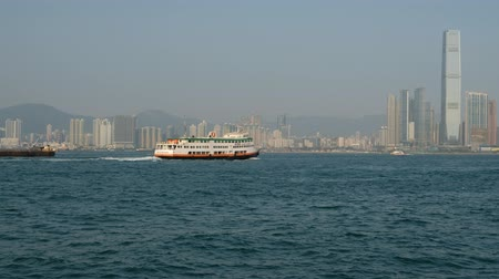 icc : First Ferry boat and ships on Victoria Harbor in Hong Kong Stock Footage
