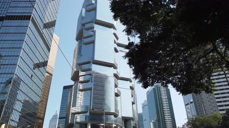 bank tower : Driving in modern office buildings, skyscrapers in Hong Kong business district Stock Footage
