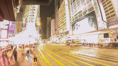 nearly : People walking, crossing street in Hong Kong city at night time lapse Stock Footage