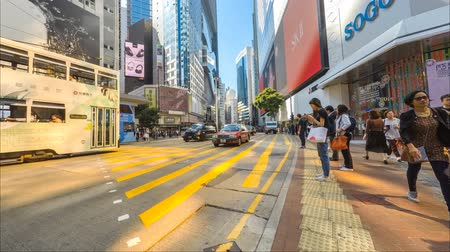 central business district : People crossing street in Hong Kong city traffic time lapse in shopping district