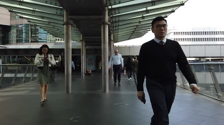 Hyper lapse of people in business district of Hong Kong