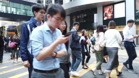 Business people crossing crowded street in Hong Kong, Central district