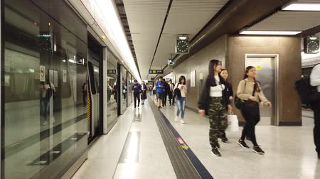 nearly : People walking in underground metro MTR train station in Hong Kong, Central, Stock Footage