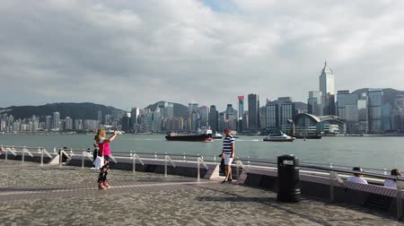 Hyper lapse of people at Victoria Harbor waterside in Hong Kong Tsim Sha Tsui