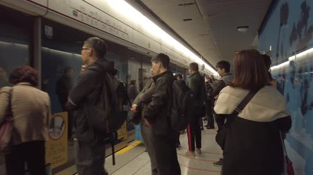 People walking in shopping mall and metro MTR train station hyper lapse TST Stock Footage