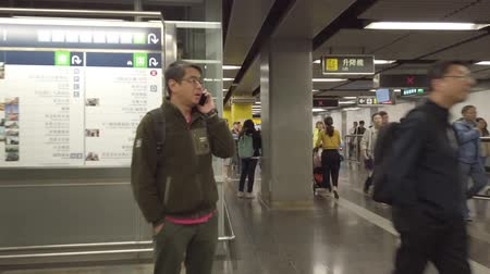 Walking on street and underground metro MTR train station in HongKong