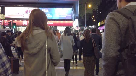 People on crowded street in shopping district of Hong Kong, Tsim Sha Tsui Stock Footage