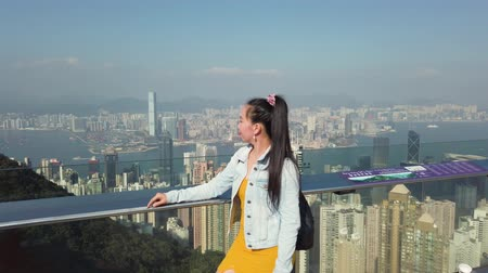 People on Victoria Peak Tower looking at Skyline of Hong Kong