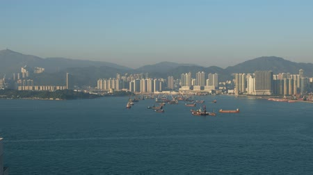 dredging : Skyline and coast and ships near industrial harbor in Hong Kong Victoria Harbor Stock Footage