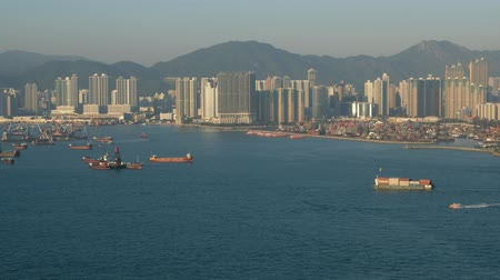 Skyline and coast and ships near industrial harbor in Hong Kong Victoria Harbor Vídeos